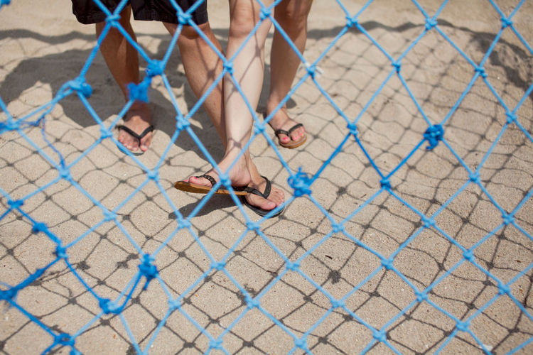 View Of Legs Through Blue Net