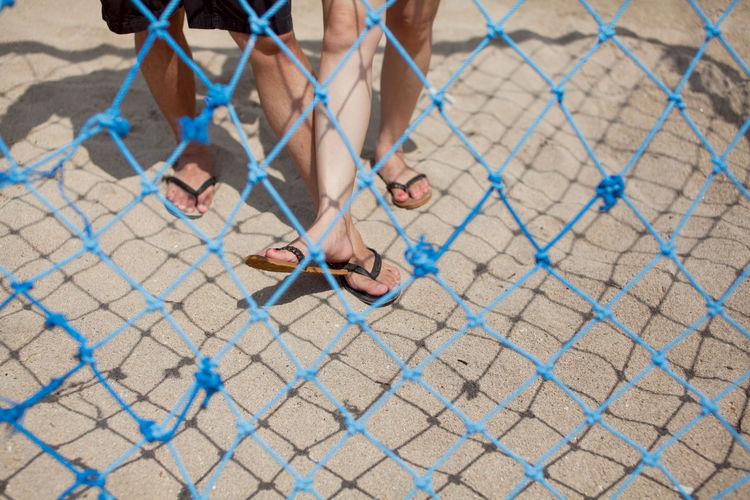 View of legs through blue net