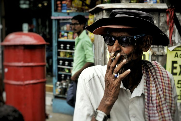 A cigarette is all he can own in his poverty. EyeEm Selects Aged OldmanEyeEm Best Shots Only Men One Man Only Adult Adults Only One Person Focus On Foreground Front View People Men Headwear Portrait Outdoors Day Young Adult