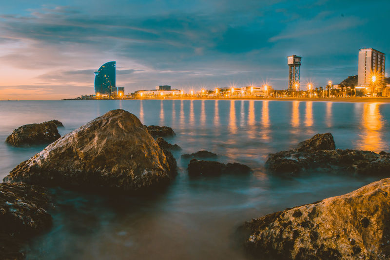 Barcelona beach, calmness during the sunrise Barcelona SPAIN Barcelona, Spain Sunrise Destination Travel Destinations Travel Photography W Hotel Skyscraper Rock - Object Beach Beachphotography Nature Nature Photography Naturelovers