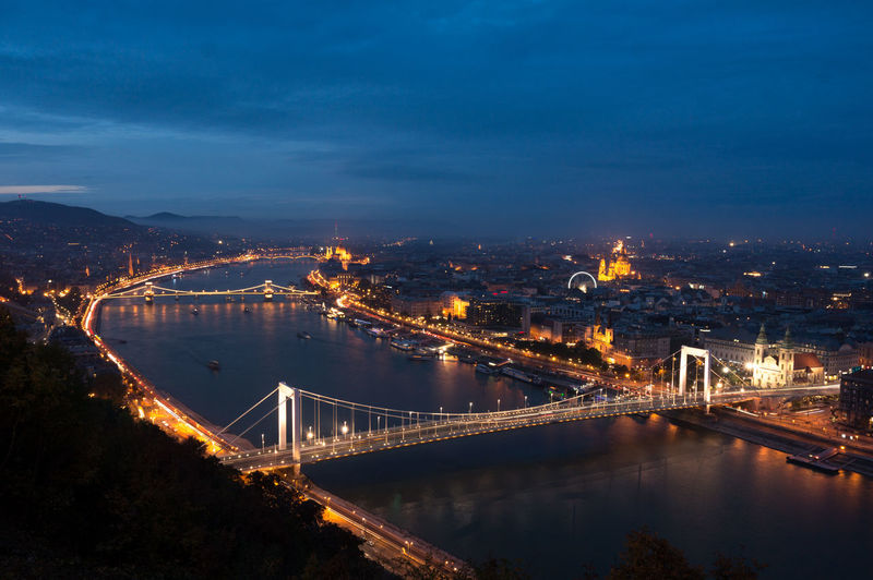 High Angle View Of Illuminated Bridge Over River In City