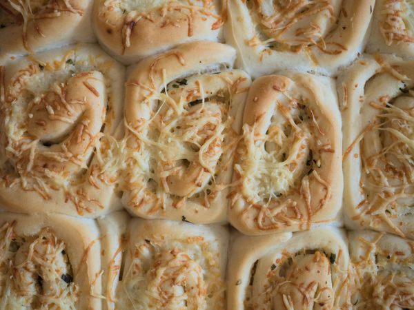 Savory dinner rolls filled with herbs, garlic and butter topped with grated cheese Bread Roll Dinner Rolls Herbs Baking Bread Buns Butter Cheese Close-up Food Food And Drink Grated Cheese No People Rolls