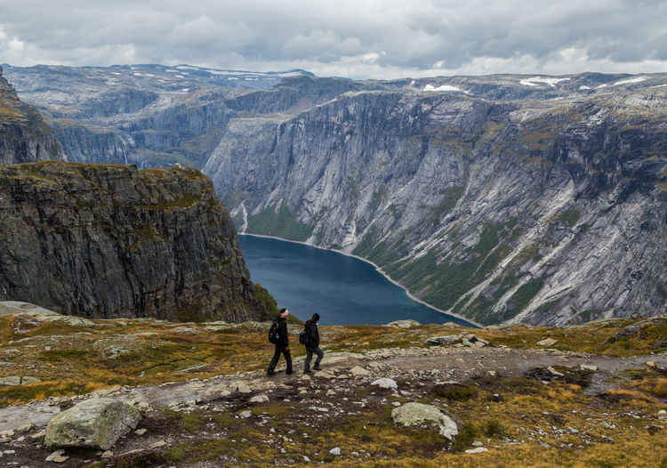 Mountain Beauty In Nature Scenics - Nature Leisure Activity Hiking Rock Activity Adventure Mountain Range Landscape Formation Nature Trail Trolltunga