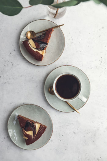 Cup of black coffee with chocolate cakes on white table. The concept of breakfast, flat lay, top view. Coffee Cake Breakfast Morning Cup Cappuccino Background Drink Top Pastry Table Chocolate Cafe Espresso White Hot Americano View Dessert Bread Food Fresh Brown Rustic Break Minimalist Minimal Cotton Beige Golden Atmosphere Sweet Above Flat Lay Composition Ceramics Mug Black Time Food And Drink Coffee - Drink
