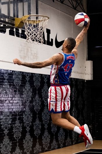 Animal from Harlem Globetrotters Lifestyles Real People People Sport Full Length Rear View Motion Leisure Activity Basketball Hoop Basketball - Sport