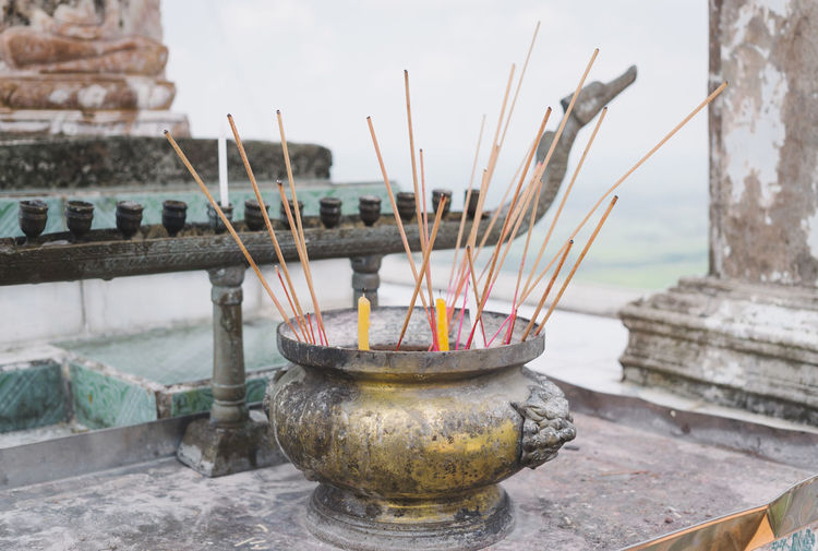 Thailand Travel Travel Photography Traveling Ash Buddhism Buddhist Temple Built Structure Burning Close-up Cultures Day Focus On Foreground Incense No People Outdoors Place Of Worship Religion Shrine Spirituality Tradition Travel Destinations
