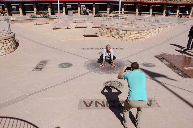 Four corners monument Casual Clothing Full Length Leisure Activity Lifestyles Boys Park - Man Made Space Focus On Foreground Day Innocence Geometric Shape Outdoors Vacations Four Corners Taking Photos Taking Pictures Portrait Of A Woman Portrait Of A Friend Tourism Tourist Attraction  Tourist Destination USA USAtrip Young Adult 4 States Corner