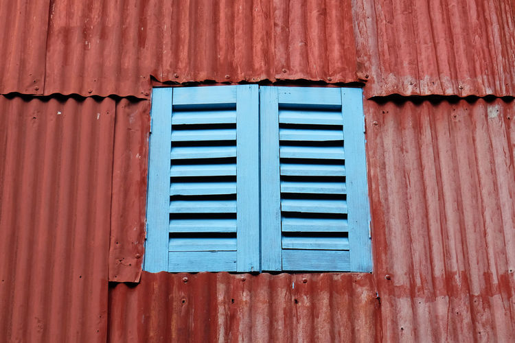 Old rustic folding old metal door gate. Architecture Backgrounds Building Building Exterior Built Structure Closed Corrugated Corrugated Iron Day Full Frame Iron Metal No People Old Outdoors Pattern Security Sheet Metal Wall - Building Feature Weathered Window Wood - Material