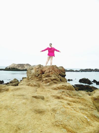 Freedom Beach Full Length One Person Arms Outstretched Rock - Object Adult Pink Color Sea Human Body Part People Carefree Standing Summer Day Adults Only Horizon Over Water Vacations Sky One Woman Only