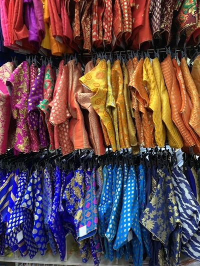 Traditional clothing for sale at market stall