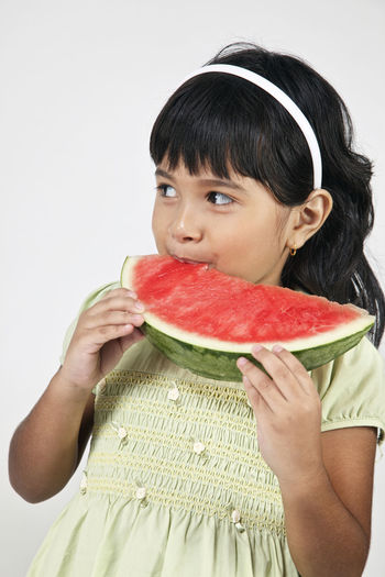 malaysia malay girl eating watermelon Asian  Innocence Kids Bangs Childhood Cute Elementary Age Food Food And Drink Freshness Fruit Hairstyle Healthy Eating Holding Leisure Activity Lifestyles Malay Malaysia One Person Portrait Studio Shot Watermelon Wellbeing White Background Women