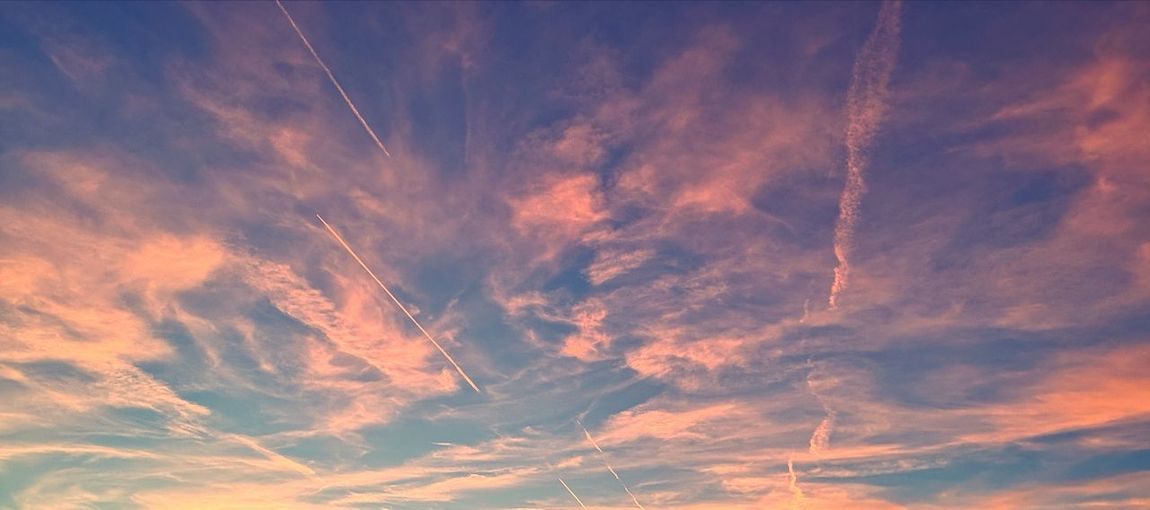 Low Angle View Of Vapor Trail In Sky During Sunset