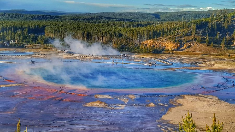 colors of grand prismatic Yellowstonenationalpark Adventuretime Yellowstone Bewild Camping Backpacking Grandprismatic Hotsprings Usnationalparks Colors View Trip Traveljunk Travelstagram Travelblogger Exploring Neverstopexploring  Travel Photography Eyemphotography Eyem Landscape_Collection Eyem Gallery Visual Creativity The Great Outdoors - 2018 EyeEm Awards Hot Spring Water Mountain Steam Volcanic Landscape Geyser Lake Landscape Travel Sky Volcanic Activity Volcanic Rock Volcano Geology