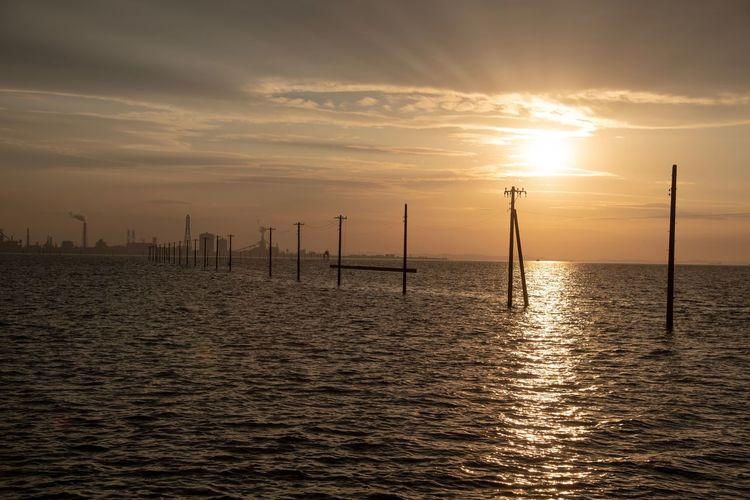 Nikon Z6 Nikon Japan EyeEm Selects Sky Sunset Water Beauty In Nature Sea Scenics - Nature No People Sun Sunlight Silhouette Waterfront Tranquil Scene Cloud - Sky Tranquility Orange Color Nature Idyllic Horizon Horizon Over Water Outdoors
