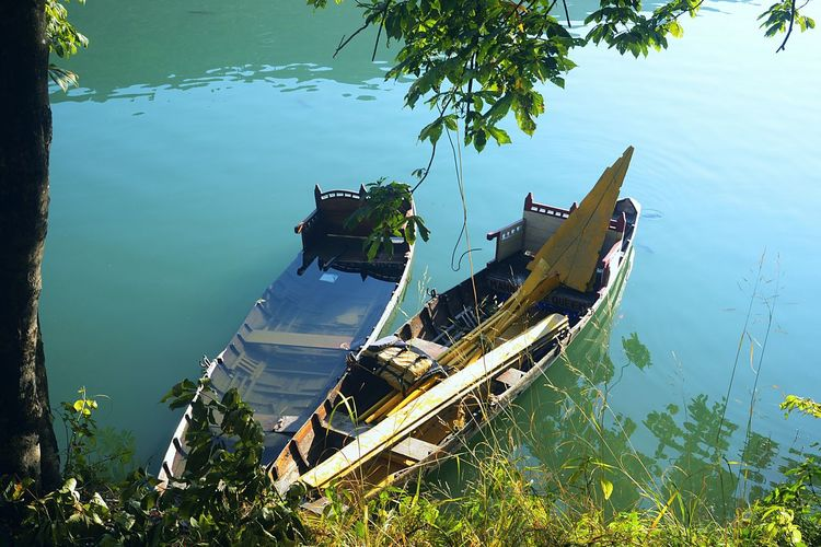 High angle view of abandoned boats moored in lake