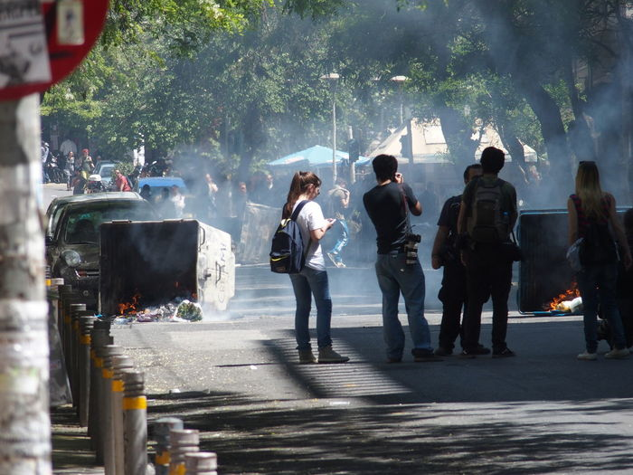 Demonstration in Athens, may 2015 Athens City Life Demonstration Lifestyles May 2015 Medium Group Of People Protest Reporter Road Smoke Street