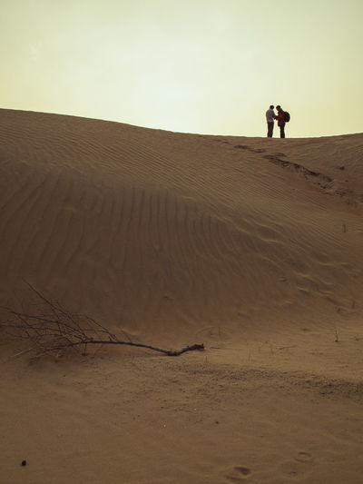 Land Desert Arid Climate Climate Landscape Scenics - Nature Sand Sand Dune Leisure Activity Nature Sky Real People Standing Environment Tranquility Tranquil Scene Lifestyles Remote Non-urban Scene Beauty In Nature Outdoors People