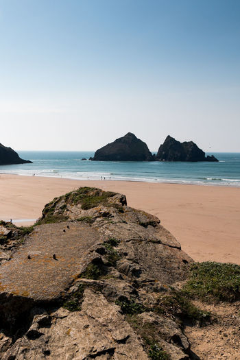 The view at Holywell Bay, Cornwall Beach Beauty In Nature Blue Clear Sky Copy Space Cornwall Cornwall Uk Horizon Horizon Over Water Land Nature No People Ocean Outdoor Photography Outdoors Rock Rock - Object Rock Formation Scenics - Nature Sea Sky Solid Tranquil Scene Tranquility Water