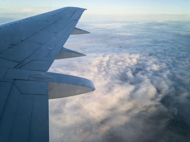 Airplane wing above clouds in air Aerial View Air Vehicle Aircraft Aircraft Wing Airline Airplane Airplane Wing Close-up Cloud - Sky Clouds Clouds And Sky Day Flying Jet Journey Mode Of Transport No People Outdoors Sky Transportation Travel Wing