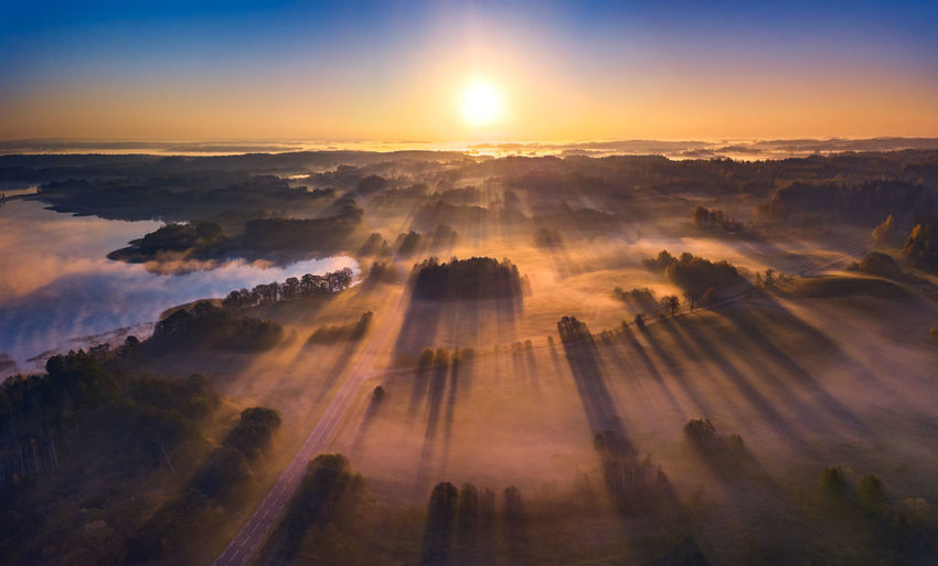 Aerial view of epic light rays over the fields at Autumn Cloud - Sky Sky Beauty In Nature Scenics - Nature Tranquility Sun Tranquil Scene Nature Idyllic Sunbeam Dramatic Sky No People Environment Aerial View Fog Outdoors Sunlight Majestic Landscape Sunrise Lightrays Epic Lithuania Nature Fineart