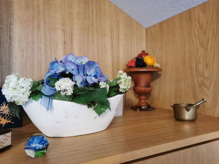 Close-up of potted plants on wooden table