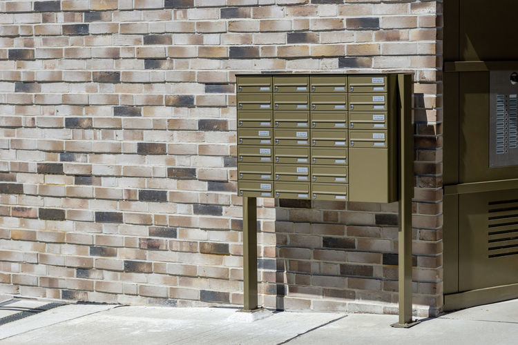 mailboxes at the wall of building in rostock Architecture Built Structure Building Exterior Wall - Building Feature Window Outdoors No People Brick Wall Building Entrance Day Sunlight Absence Brick Wall Pattern Door Staircase Empty Wood - Material Mailboxes Mailbox