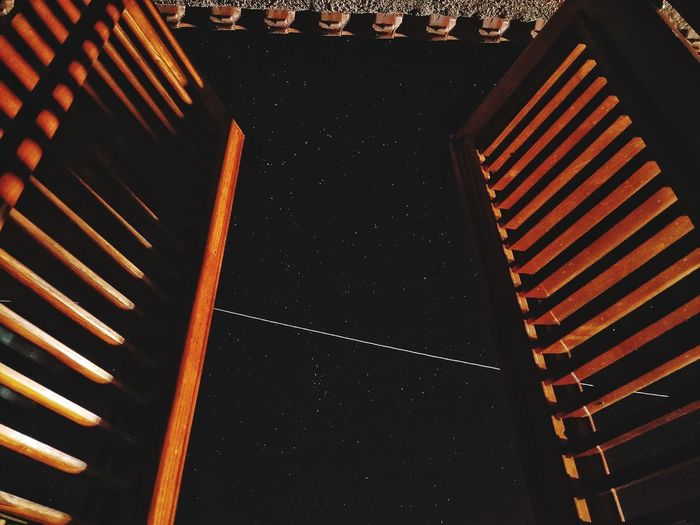 High angle view of illuminated staircase in building