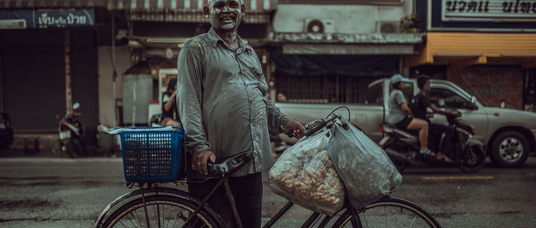 Life Songkarn Festival Architecture Bicycle Building Exterior Built Structure City Day Focus On Foreground Incidental People Land Vehicle Lifestyles Mode Of Transportation One Person Outdoors Real People Ride Riding Road Street Three Quarter Length Transportation