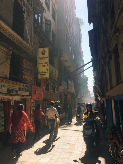 Nepal Building Exterior Architecture Built Structure City Real People Street Sunlight Walking Travel Destinations Day Kathmandu Ancient Ancient City Old Old Town Old Buildings Life