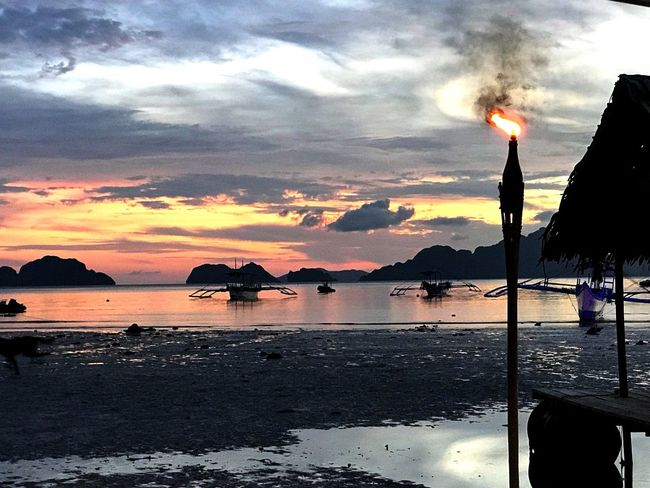 As the sun burned its last flame... Enjoying Life Beach Life Enjoying The View Life Is A Beach EyeEm Gallery Travel Photography EyeEm Best Shots Eye4photography  EyeEm Nature Lover Eyeem Philippines Travel Destinations Palawan El Nido Sunset_collection Water Sky Beach Sunset Cloud - Sky Sea Nature Orange Color Beauty In Nature