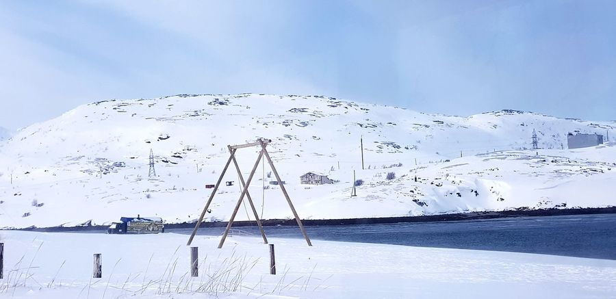 The Swing Swing Snow Snow Covered Ocean Sea Murmansk Teriberka Sea And Sky Russia EyeEm Selects Water Sea Beach Cold Temperature Snow Rural Scene Blue Seascape Coastal Feature Snowcapped Mountain Dramatic Landscape Coast