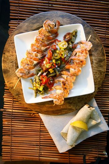 High angle view of seafood in skewer on plate