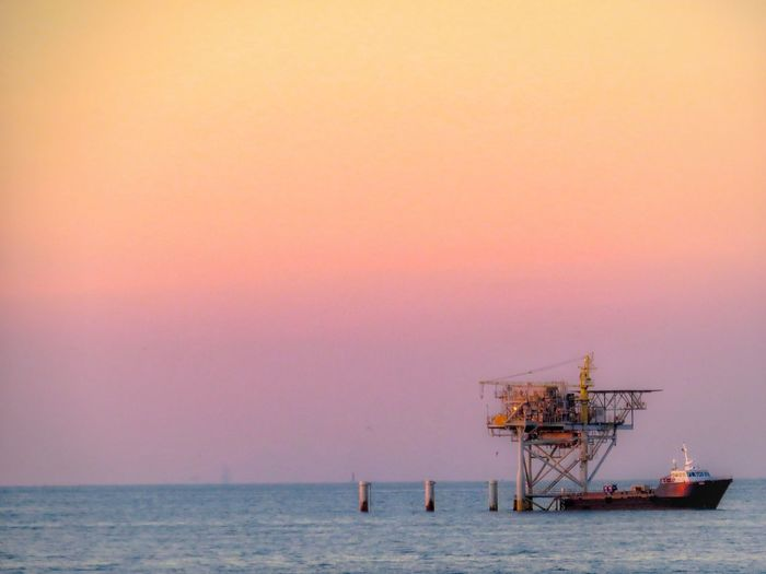 off shore industry Sunset Dramatic Sky Nature Outdoors EyeEm Selects Drilling Rig Offshore Platform Oil Pump Water Sea Nautical Vessel Sunset Oil Industry Industry Business Finance And Industry Natural Gas Refinery Oil Well Harbor Ship