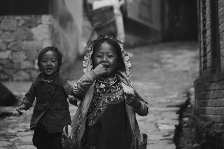 EyeEmNewHere The Photojournalist - 2017 EyeEm Awards The Street Photographer - 2017 EyeEm Awards Childhood Real People Girls Happiness Two People Smiling Focus On Foreground Togetherness Elementary Age Front View Night Boys Looking At Camera Outdoors Lifestyles Bonding Cheerful Portrait Friendship Young Adult Blackandwhite
