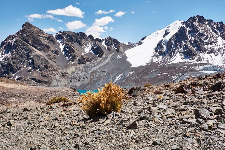 Scenic view of snowcapped mountains against sky - pico austria hiking trail cordillera real bolivia