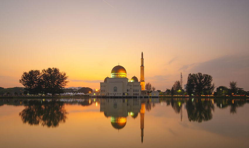Architecture Belief Building Exterior Built Structure Dome Government Lake Mosque Nature No People Outdoors Place Of Worship Reflection Religion Sky Spire  Spirituality Sunset Travel Destinations Tree Water Waterfront