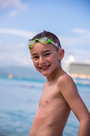 Portrait Shirtless Looking At Camera Happiness Real People One Person Smiling Boys Focus On Foreground Sky One Boy Only Childhood Leisure Activity Water Lifestyles Fun Males  Day Front View Cheerful Vacation Cruise Royal Caribbean Cruise