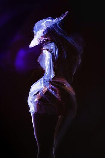 Close-up of illuminated light painting against black background