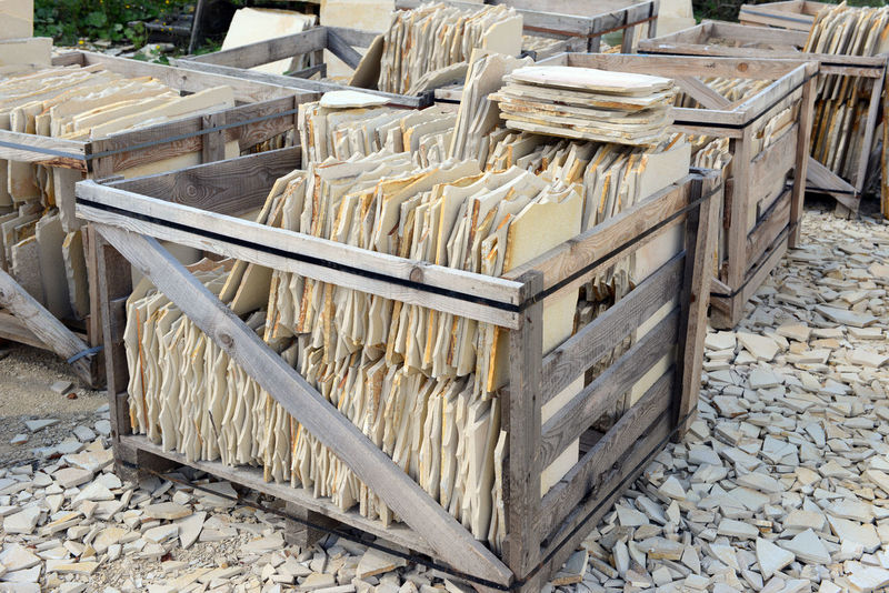 boxes with paving stones of limestone. Solnhofen Stones Stonemasons Stonemason Art Paving Stone Paving Stones Stonemason Paving Paving Blocks Tools Tool Limestone Box Production