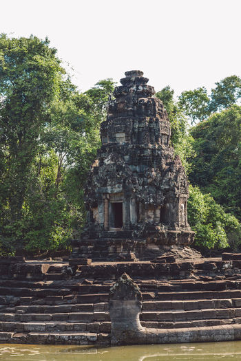 Siem Reap Cambodia Angkor Architecture Tree Place Of Worship Religion Built Structure Belief Plant History The Past Spirituality Ancient Sky Nature Old Building Exterior Day Old Ruin Travel Destinations Travel No People Ancient Civilization Outdoors Ruined Archaeology