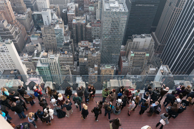 High angle view of people on building terrace in city
