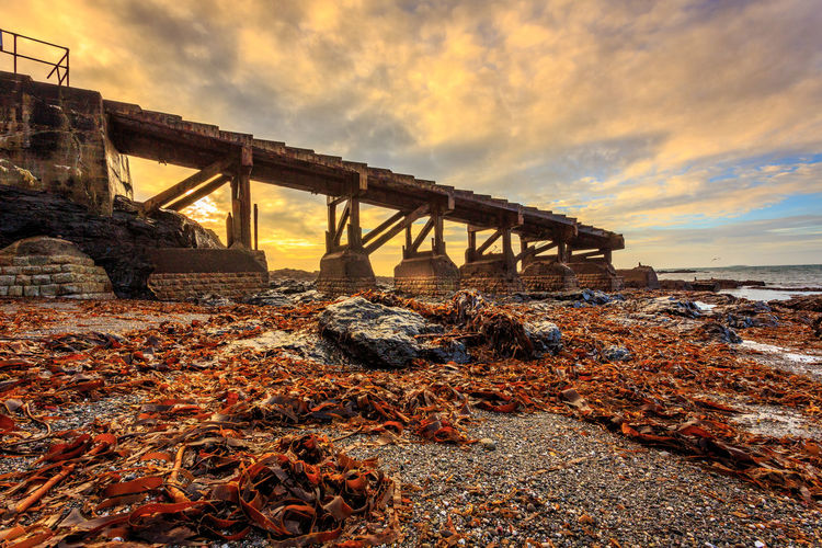 Old RNLI Lifeboat station bathed in early morning sunshine at the Lizard Point on the coast of cornwall, South West England Architecture Beach Beachphotography Beauty In Nature Bridge - Man Made Structure Built Structure Canon Cloud - Sky Connection Cornwall Cornwall Uk Day Horizon Over Water Nature No People Outdoors RNLI Sea Sky Slipway Sunrise Sunset Water