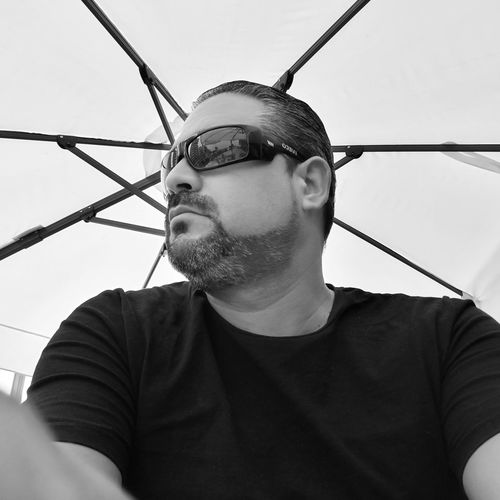 Low angle portrait of man wearing sunglasses
