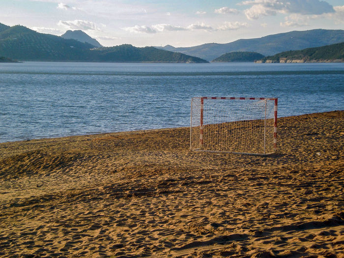 football goal in the sand of a marsh Football Summer Beach Mountain Tranquility Sport Nature Water Outdoors Sand Competition Soccer Team Game Landscape Activity Goalie Swamp Stadium Curiosity Mystery Sky No People Vacations Leisure Activity First Eyeem Photo