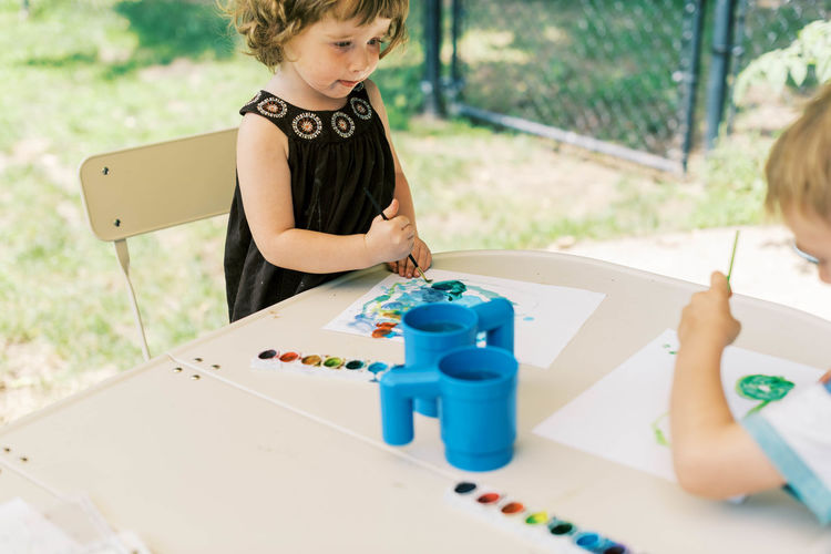 Cute girl playing with toy on table
