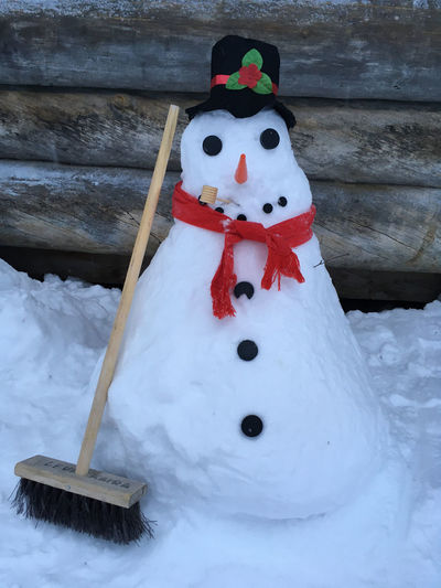 Close-up of christmas decoration on snow during winter