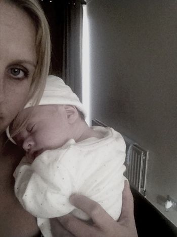 Baby Cuddles Off Mama