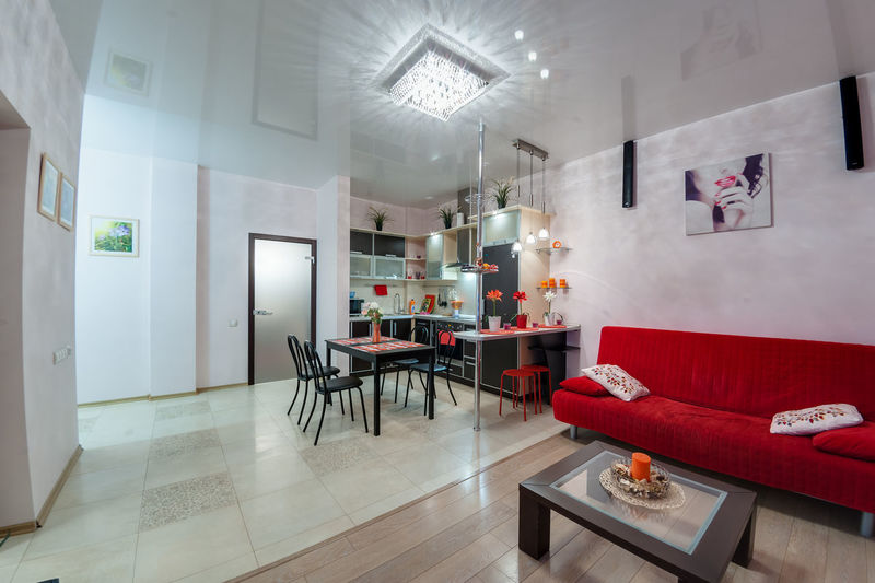 Table Indoors  Flooring Seat Furniture Lighting Equipment No People Home Interior Illuminated Chair Architecture Modern Wall - Building Feature Domestic Room Business Absence Home Showcase Interior Red Sofa Empty Luxury Ceiling Tiled Floor Electric Lamp