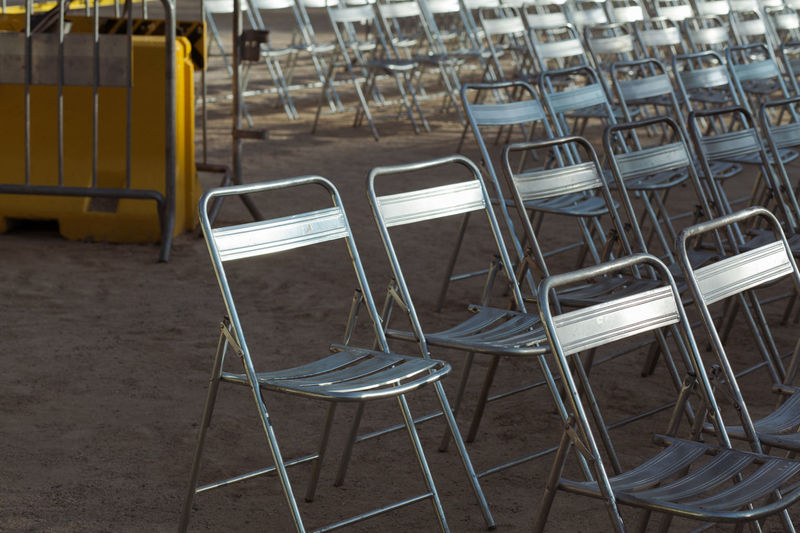 Arena Audience Beautifully Organized Chair Chair Chairs Concert Day Empty Foldable In Row Metal Metallic No People Outdoors Row Of Things Seat Seats Wet
