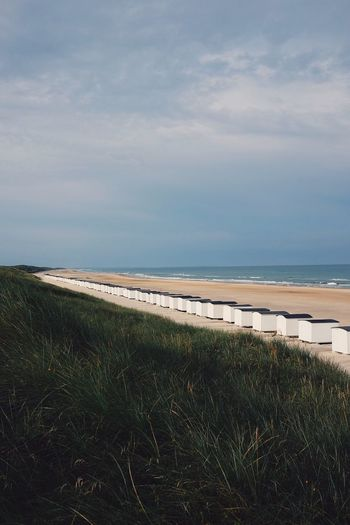 Beach Huts Denmark Sea Beach Water Grass Scenics Tranquility Nature Beauty In Nature Beachhut Beach Photography Beachphotography Beach Life BeachHouse Beachhuts Beach Hut Denmark